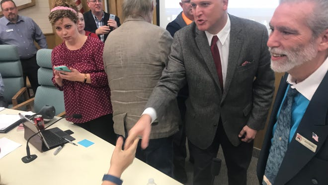 Travis Seegmiller, middle, shakes hands and chats with Republican delegates Monday after winning an eight-way race to be named as the interim replacement for former state Rep. Jon Stanard, who resigned last week ahead of allegations that he'd paid for a prostitute while visiting Salt Lake City hotels on legislative business.