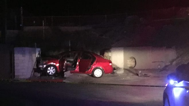 A car appears to have collided into a concrete barrier Thursday along East Palm Canyon Drive in Palm Springs.