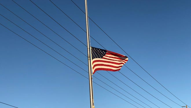 A flag flying at half-staff on Thursday afternoon in Visalia.