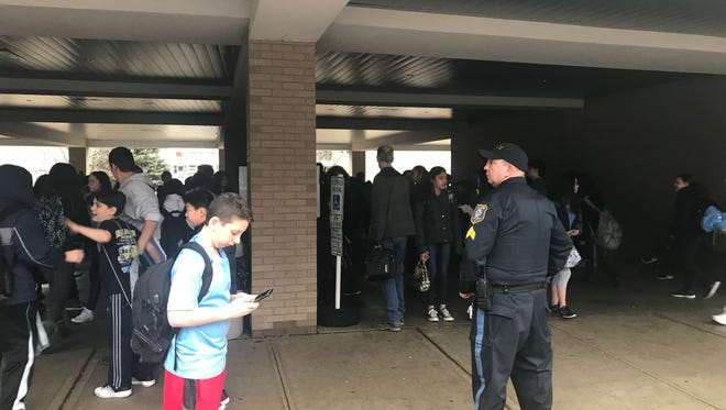 Students are dismissed under police supervision at Brooklawn Middle School after a lockdown was called at the school just before dismissal. Feb. 16, 2018