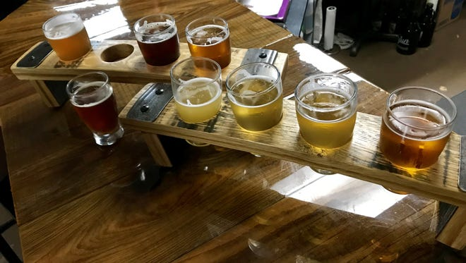 A flight from Cajun Brewing in Lafayette, served in repurposed barrel staves.