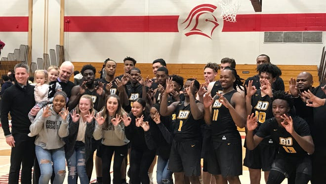 Members of the Brown Deer boys basketball team pose after securing a sixth straight conference title with an 82-79 win over Milwaukee Lutheran on Feb. 16.