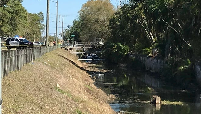 Police blocked off the roads near Jackson and Canal streets in Fort Myers, where a police officer drove a police car into a canal Saturday afternoon.