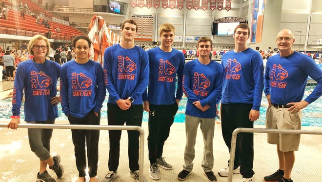 The San Angelo Central High School swimmers and coaches were all smiles at the UIL state meet in Austin on Friday. From left to right are: assistant coach Val Hague, Sophie Forbes, Riley Hill, Ryan Brown, Josiah Hargett, Alex Tucei and head coach David Hague.
