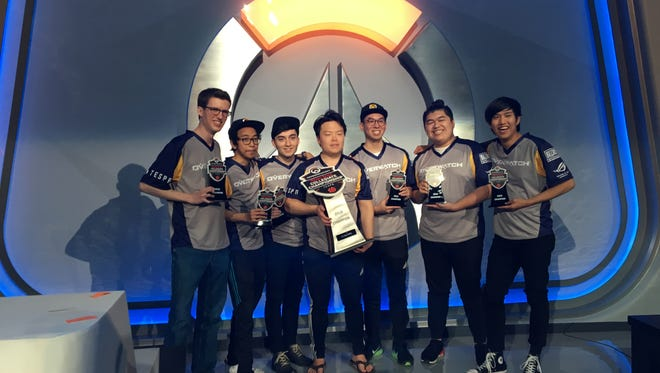 The UC Berkeley Overwatch team poses with their trophy after winning 3-0 over UC Irvine Saturday.