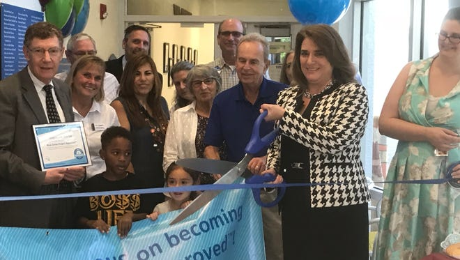 Staff at the Guadalupe Center in Immokalee celebrate becoming a Blue Zones Project worksite in Immokalee on Friday, Feb. 16, 2018.