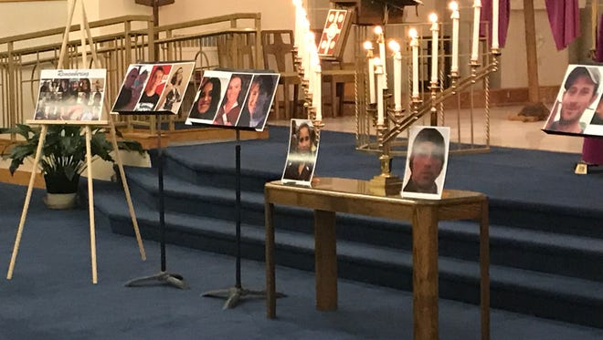 The altar at Our Mother of Sorrows Church in Greece was adorned with pictures of the 17 people who died in last week's school shooting in Florida.