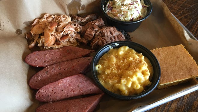 Mission BBQ's Classic #41 sausage, pulled chicken, moist cut beef brisket paired with Maggie's Mac-N-Cheese and slaw with cornbread.