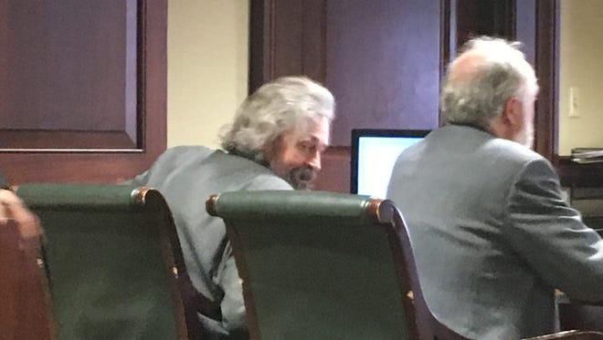 Brendan MacDonald, at left, taking his seat before closing arguments Tuesday in his trial in Hamilton County Common Pleas Court.