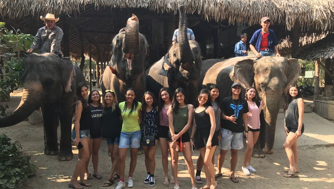 The Warriors girls basketball team toured the Maetaman Elephant Camp in Chiang Mai, Thaland. The camp is known for taking in elephants that were born in captivity and caring for them through volunteer efforts and donations.