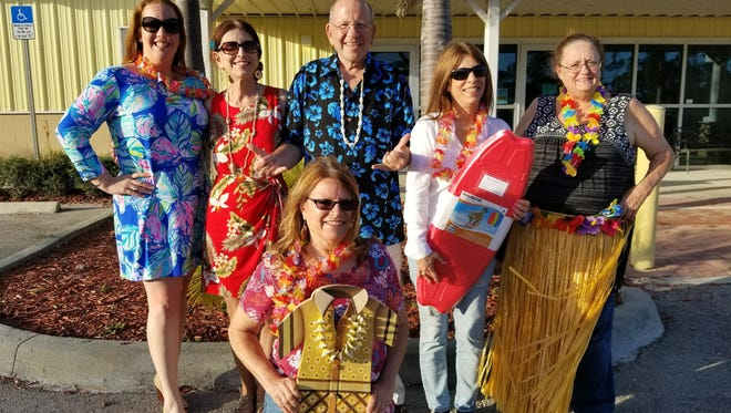 Getting ready for Paws in Paradise on March 10 are HSSLC vice president Lillian Ewen, board member Mary Jean Navaretta, chairman Steve Navaretta, board member Joyce McGuire, and board member Pam Landers, with board member/secretary Joanne Ferrara in  the very front.