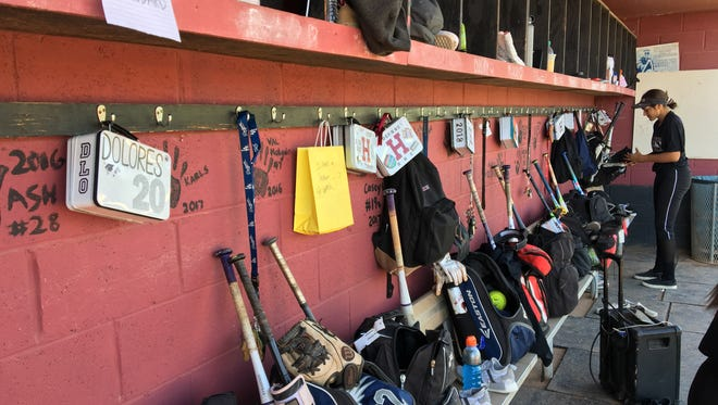 Lunch boxes hangs in the Chandler Hamilton softball dugout.