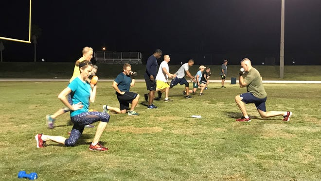 Rockledge Director of Public Safety Joseph P. LaSata leads a high-intensity interval training session at Rockledge High School.