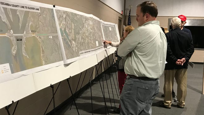Milton Mayor Wesley Meiss looks at Florida Department of Transportation maps from the agency's study on the widening of U.S. 90. FDOT held a public hearing for interested people to ask questions and evaluate plans for the future of the nearly 11-mile roadway from Scenic Highway in Pensacola to Glover Lane in Santa Rosa County. Approximately 100 people attended the one-hour hearing on Thursday, Feb. 22, 2018 at the Santa Rosa County Auditorium in Milton.