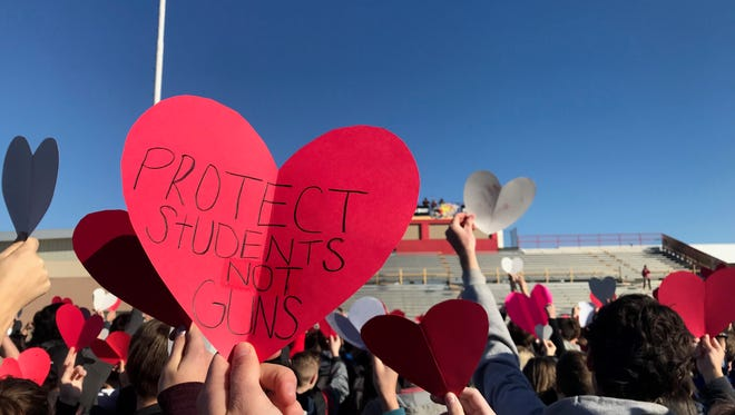 Scottsdale Chaparral High School students walk out on Feb. 23, 2018, the third day of nationwide demonstrations following the mass shooting at a Florida high school.