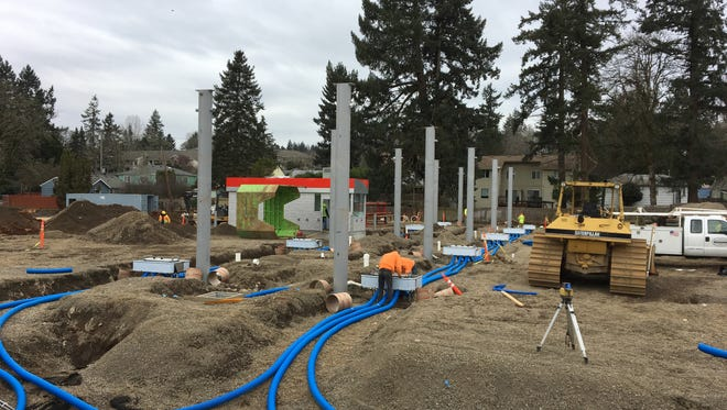 Construction work at 3415 Commercial St. SE in Salem, Oregon, on Feb. 23, 2018. Contractors are constructing a new Fred Meyer fueling station.