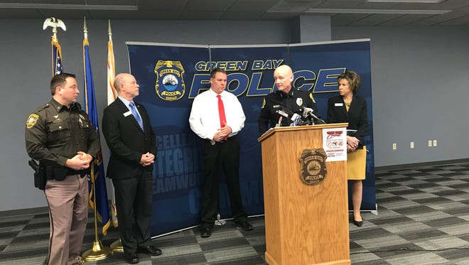Green Bay Police Chief Andrew Smith put forth a proposal Friday to bring armed security guards into each of Green Bay School District's buildings. Also in attendance were Brown County Sheriff's Chief Deputy Todd Delain, Green Bay School Board member Ed Dorff and Green Bay Schools Superintendent Michelle Langenfeld.