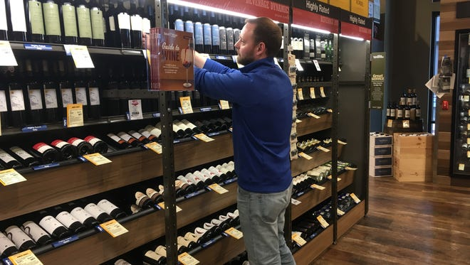 Tony Rasmussen, manager of Total Wine & More at Greenfield's 84 South shopping and dining development, stocks shelves Friday in preparation for the store's grand opening next Thursday.