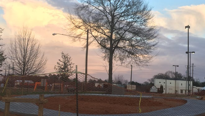 A memorial site honoring slain Hattiesburg police officers Benjamin J. Deen and Liquori Tate is under construction on Fourth and Ryan streets near the site where they were killed during a traffic stop May 9, 2015.
