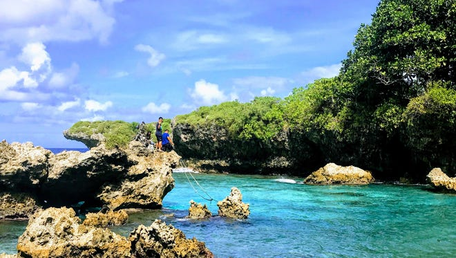 Kingdom Seekers Youth members prepare to jump into the waters of Ague Cove.