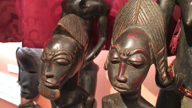 This Blolo bian, or Spirit Husband, left, and Blolo bla, or Spirit Wife, are divination figures of the Baule people of Ivory Coast on display at the at the Houamla Collection of African Arts in Yigo on Saturday, Feb. 17, 2018. Visit the museum to learn more about the beliefs of the Baule.