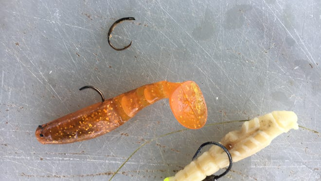 Two lures and a broken hook were in the belly of JD's redfish that went home for dinner.