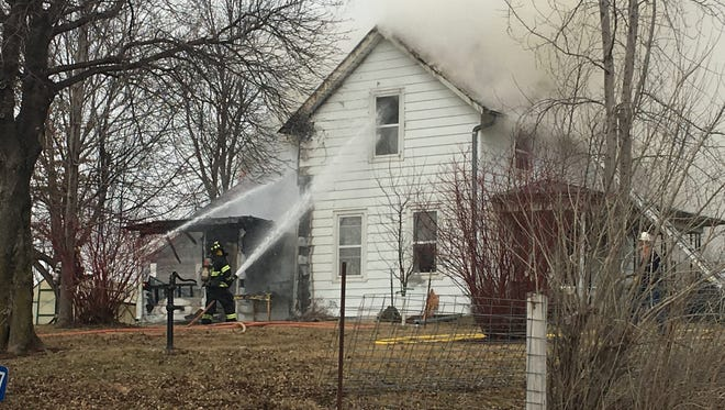 Firefighters are shown battling a fire at 3867 James Ave. SW outside of Iowa City on March 2, 2018