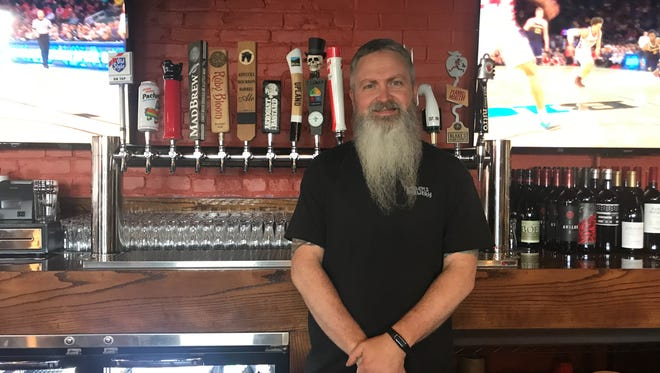 John Mills ll is the owner and brewer at Maidens brewpub which opens Friday, March 2018. The Bar and tables are all handmade by Mills.