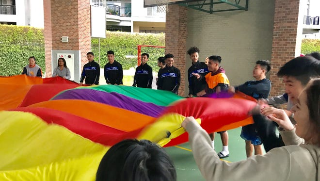 St. Paul Christian Warriors' basketball team participate in a game with students from Taiwan Sunshine during the 2018 Asian Christian Schools' Conference Boys' Basketball Tournament's service mission.  The boys held a basketball clinic and played games for the Taiwan Sunshine, a non-profit group that supports families that have children with special needs.