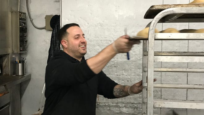 Frank Martusciello Jr. working at the family bakery