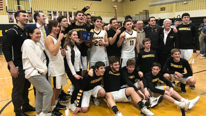 The Cresskill boys basketball team celebrates its North 1, Group 1 championship after defeating New Milford in the sectional final, 58-38, at home on Tuesday, March 6, 2018.