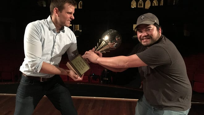 Alvin Klausen and Jim Vu, contestants in Dancing with the Salem Stars, fighting over the Mirrorball Trophy at the Elsinore Theatre.