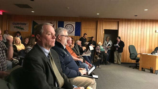 Matt Zimmerman, an attorney for Geronimo Energy (left) and Geronimo's Project Manager for Michigan David Shiftlett (right) sit in the audience during the Eaton County Planning Commission meeting Tuesday, March 6 in Charlotte.