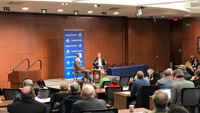 Mike Gousha interviews New York University sociologist Patrick Sharkey during a conference about crime and safety.