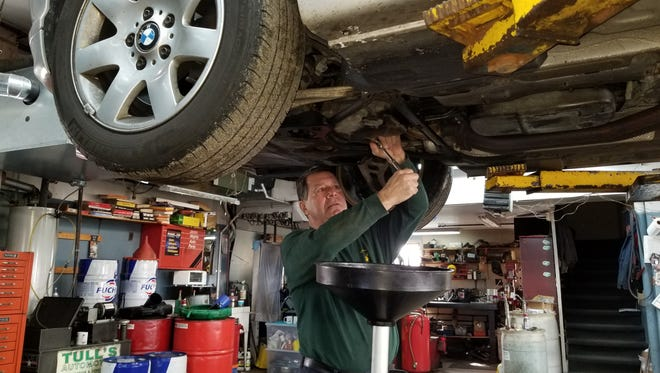 David Tullo works under a car at Tull's Auto Repair in Basking Ridge. Tullo has owned the shop for more than 40 years. Prior to its use as a repair garage, the property was used by a blacksmith and a wheelwright.