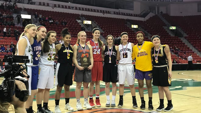 Grafton's Hannah Belanger (center) poses with the other competitors in the WIAA Three-Point Challenge Saturday.