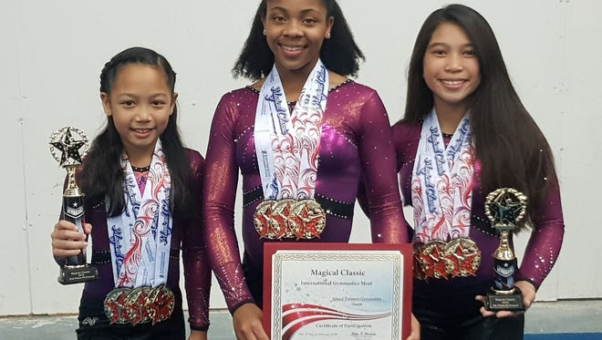 From left: Ariana Balagot, Qaydenz Montgomery and Maria Calvo competed in the Magical Classic gymnastics competition in Orlando, Florida, Feb. 16-17.