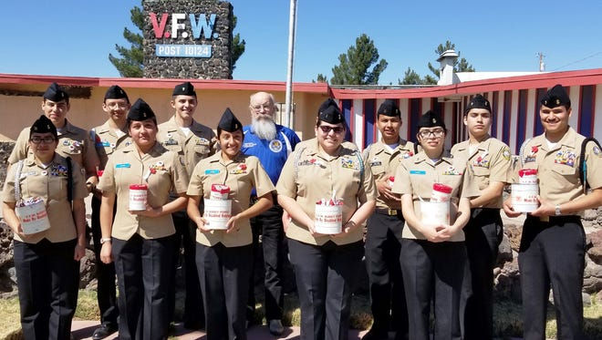 Santa Teresa High School Naval JROTC prepare for a Buddy Poppy Drive in Las Cruces.