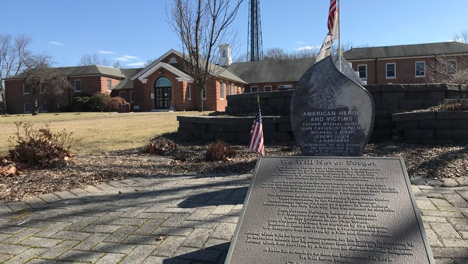 West Milford town hall is seen behind the town's 9-11 memorial on Feb. 28, 2018.