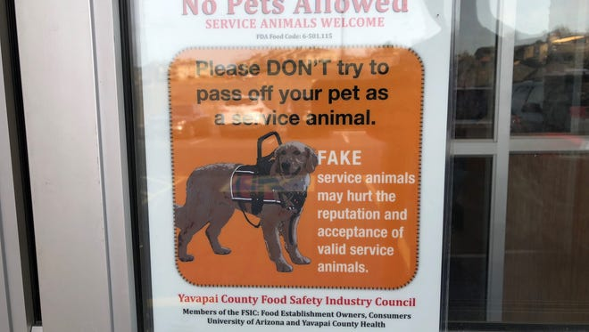 A local Prescott McDonald's implemented a sign asking pet owners not to lie about whether their pet is a service animal or not.