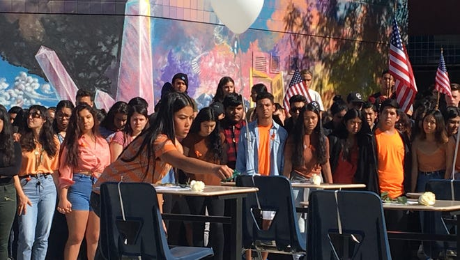 One month after a high school massacre in Florida, students across the Coachella Valley walked out of class Wednesday as part of a nationwide youth movement against gun violence. Here Cathedral City High School students rally against gun violence.