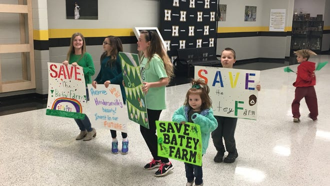 Hendersonville kids show their support for saving the Batey Farm before Tuesday night's meeting at Hendersonville High School