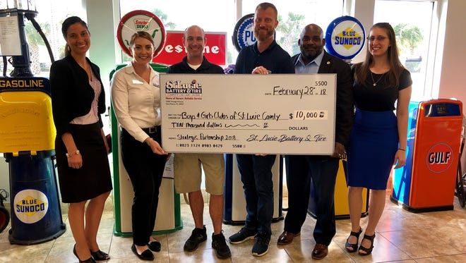 From left are Melanie Wiles, Boys & Girls Clubs of St. Lucie County;  Lindsey Concannon  Ken Walsh and Jeff Deans from St. Lucie Battery & Tire; and Will Armstead and Maygan Johnson of BGC-SLC.