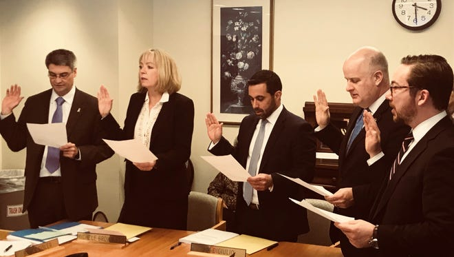 New members of the Greystone Park Psychiatric Hospital Board of Trustees are sworn in at their first meeting on March 15, 2018. From left are Bruce Sisler, Michele Brown, Jim DiGiulio, James Gannon and Peter Simon.