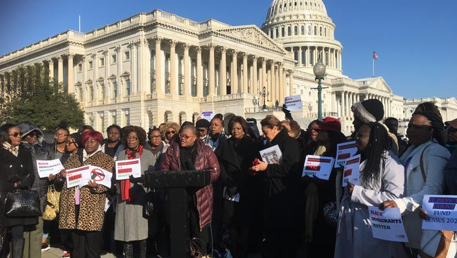 """Melanie Campbell, president of the National Coalition on Black Civic Participation, speaks outside the Capitol with attendees of the """"Time for a Power Shift"""" conference focused on training women to run for office, organize communities and protect voting rights. 3/15/2018"""