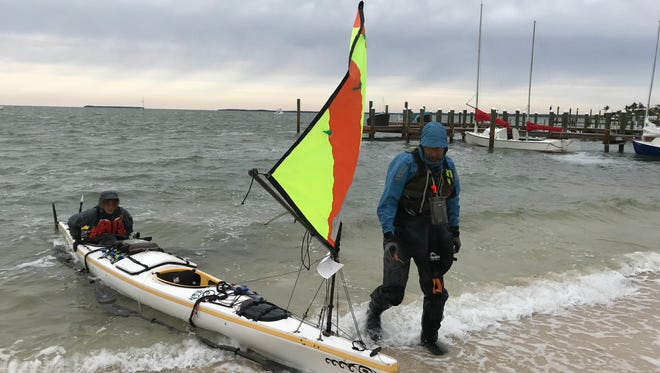 Naples father and son Mark Cecil and Maxfield Seixas at the finish line on Key Largo. The duo competed in the Everglades Challenge endurance race, paddling 300 miles from St. Pete to Key Largo.