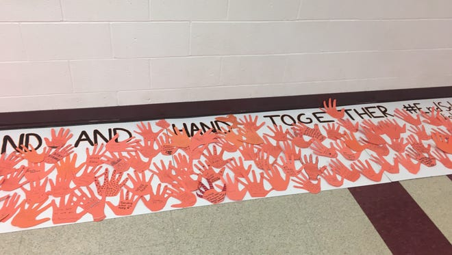 """Students at Bermudian Springs High School created a banner that said """"We stand hand in hand together #EndSchoolViolence"""" during the organized national student walkouts on March, 14, 2018."""