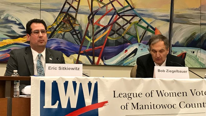Eric Sitkiewitz (left) and Bob Ziegelbauer trade views during a candidate forum Thursday.