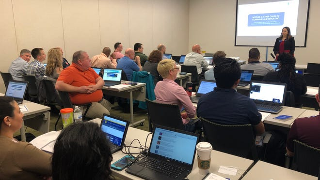 Dr. Eman El-Sheikh, UWF Center for Cybersecurity director, presents Tuesday, March 20, at the inaugural training session for state agency personnel at the Florida Department of Revenue Building 1 in Tallahassee.