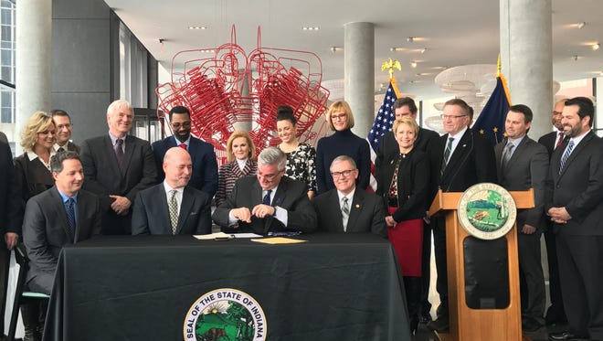 Gov. Eric Holcomb signs two workforce development bills at Cummins global distribution headquarters in downtown Indianapolis on Wednesday, March 21, 2018.